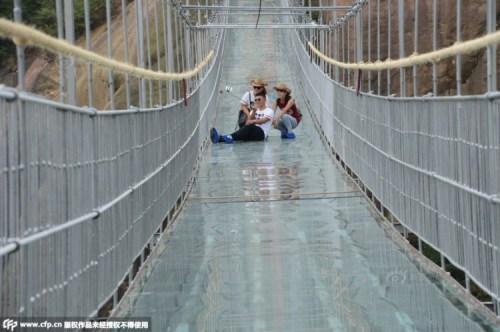 Tourist-Selfie-on-Glass-Suspension-Bridge